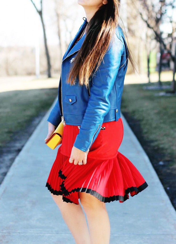 coach collection blogger blue leather jacket red dress dinky bag