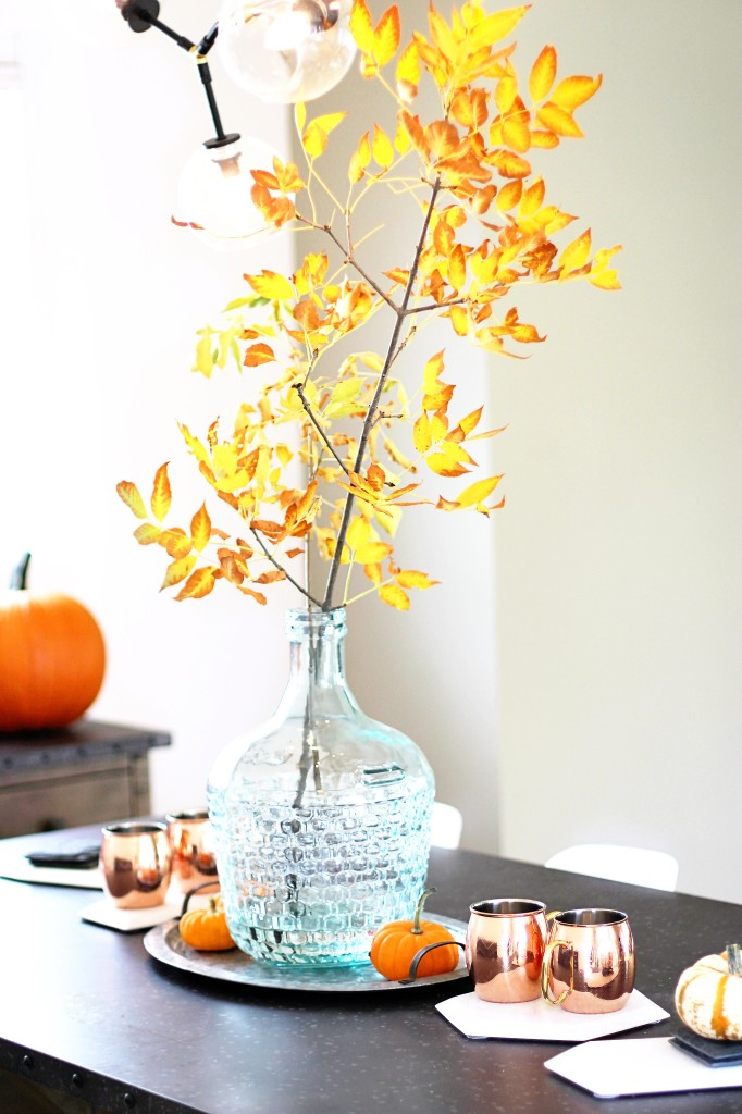 fall home decor ideas modern teal glass vase branches pumpkins