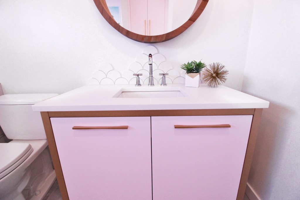 pink bathroom gold lighting geometric marble chevron tile marble fish scale round vanity mirror
