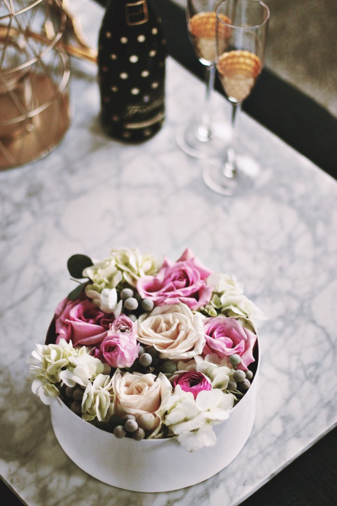 hat box floral arrangement best edmonton florist polka dot champagne trendy bottle gold flute drink marble coffee table The brick