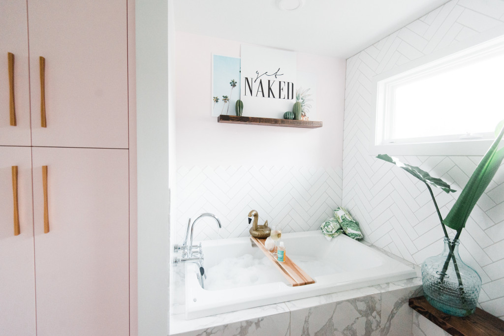 pink marble bathroom Get Naked sign tropical design herringbone chevron tile walls bathroom