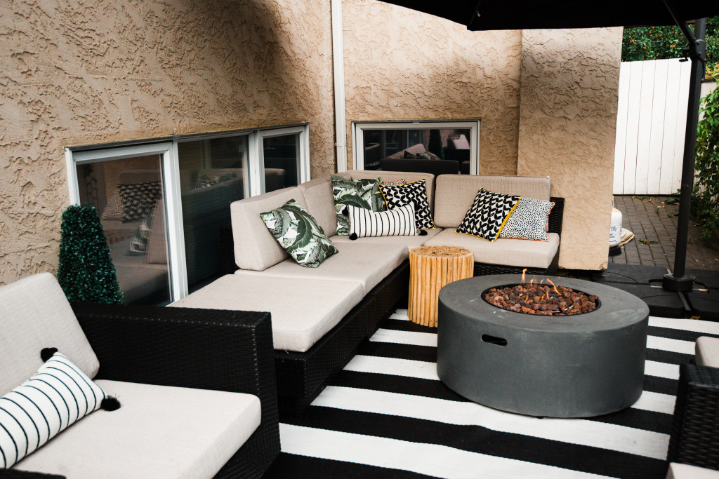 patio small spaces ideas black white rug round modern fireplace The Brick oversized outdoor umbrella Airedale terrier solar panelled lighting banana leaf pillow design Canadian