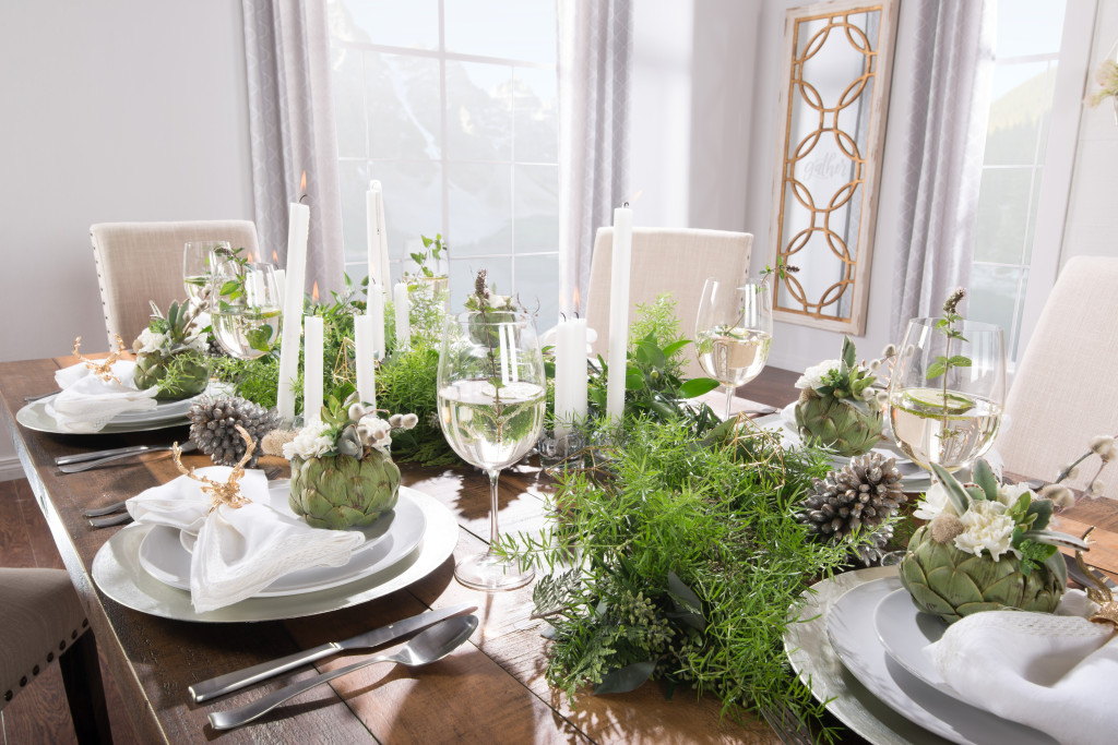 winter christmas table setting tablescape garland centre piece artichoke florals gold antler akin rings how to rustic wood table